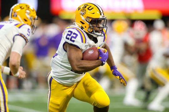 Dec 7, 2019; Atlanta, GA, USA; LSU Tigers running back Clyde Edwards-Helaire (22) runs the ball against the Georgia Bulldogs in the first quarter in the 2019 SEC Championship Game at Mercedes-Benz Stadium. Mandatory Credit: Brett Davis-USA TODAY Sports