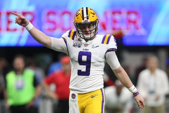 Dec 28, 2019; Atlanta, Georgia, USA; LSU Tigers quarterback Joe Burrow (9) signals during the third quarter of the 2019 Peach Bowl college football playoff semifinal game against the Oklahoma Sooners. Mandatory Credit: Brett Davis-USA TODAY Sports