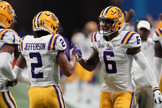 Dec 28, 2019; Atlanta, Georgia, USA; LSU Tigers wide receiver Justin Jefferson (2) celebrates with wide receiver Terrace Marshall Jr. (6) after scoring a touchdown against the Oklahoma Sooners during the second quarter of the 2019 Peach Bowl college football playoff semifinal game. Mandatory Credit: John David Mercer-USA TODAY Sports