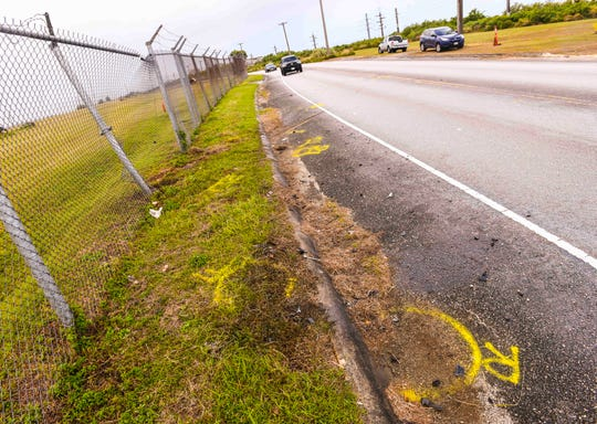 Paint markings indicate the positions of a motorcycle and automoblie, after traffic Investigators with the Guam Police Department's Highway Patrol Division conducted a collision of the two vehicles on East Sunset Boulevard in Tiyan, on Tuesday, Dec. 31, 2019. The crash that happened the night before, resulted in the death of the motocycle operator, according to Sgt. Paul Tapao, GPD spokesman.