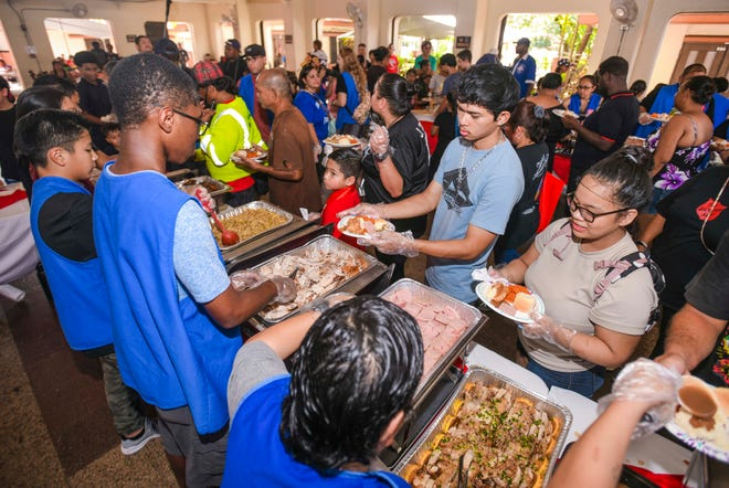 Volunteers and donors assist the Salvation Army in hosting its 23rd annual Thanksgiving Luncheon at the Chamorro Village main pavilion in Hagåtña in this Nov. 28, 2019, file photo.