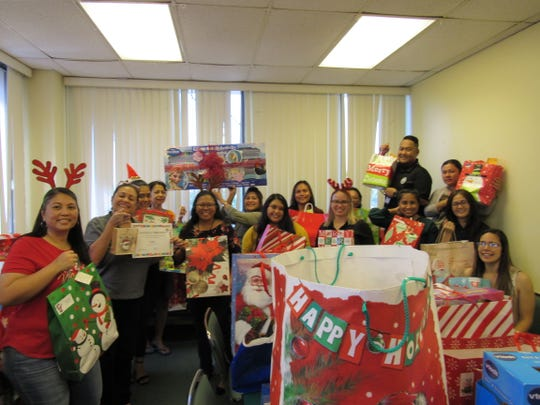 DZSP 21 LLC employees led by Business Manager Shannon Quinata and A200 Office Manager Suzette Gutierrez donated some 250 Christmas gifts to officers of Department of Public Health and Social Services in support of the department's yearly foster kids program encouraging private companies to give gifts to children of needy families, leaving no kids with no gift every Christmas. DZSP 21 LLC has supported the foster kids program annually since 2013.