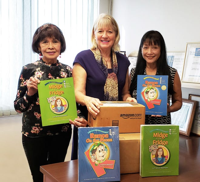 Executive Director of the Guam Diabetes Association, Winnie Butler (left) and GDA Vice President, Clara Okada Peterson (far right), receive 100 free children's books from local author Frances Baumann (center). The storybooks, which promote healthy lifestyle habits, will be used by school nurses and GDA volunteers in selected public elementary schools to promote diabetes prevention as part of GDA's annual children's outreach program which runs January to June 2020.