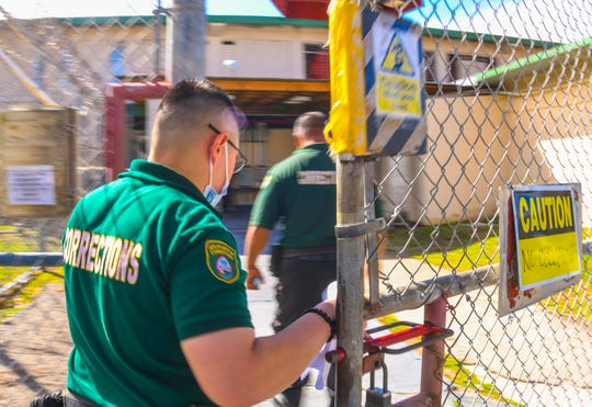 Two Department of Corrections enter the Hagåtña Facility Detention in this December 2019 file photo. PDN file photo.
