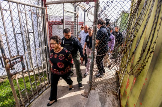 Razor wire that help to restrict certain confines at the Department of Corrections are evident as Gov. Lou Leon Guerrero, front, Lt. Gov. Josh Tenorio and others tour the facility in Mangilao on Thursday, Jan. 17, 2019.