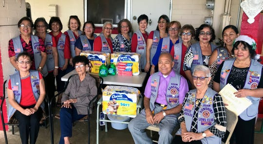 The Guam Sunshine Lions brought Christmas cheer, song, and supplies to Sylvia Punzalan, 92, (seated second from left) on Dec. 21 at her residence in Tiyan.