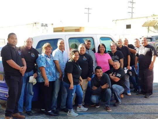 Guam Regional Transit Authority employees completed their 16 hours passenger assistance training with hands-on wheelchair securement on Dec. 28. Standing from left:  John Ignacio, Robert Santos, Connie Camacho (KEI), Radly Raymond, Hilda Ito, Frani Cruz, Abrham Inos, PAT instructor Judy V. Aguigui from Guam Community College, Michael Cruz, Benny Fegurgur, Fred Cruz, Rolando Dydasco, and Joseph Chargualaf. Kneeling from left:  Jim Pouk and Steven Cruz