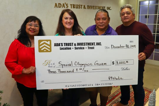 "Ada's Trust & Investment, Inc. donated to the Special Olympics Guam during the season of giving. Standing from left:  Marie M. Benito, SOGU board of director/finance chairwoman, Patricia ""Patty"" Ada, vice president Ada's Trust & Investment, Inc., Frank Florig, SOGU president/CEO and Paul Mendiola SOGU board/national sports director."