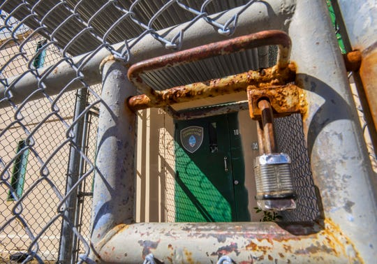 A padlock secures the gate near an secured entry into the Department of Corrections Hagåtña Detention Facilities on Tuesday, Dec. 31, 2019.