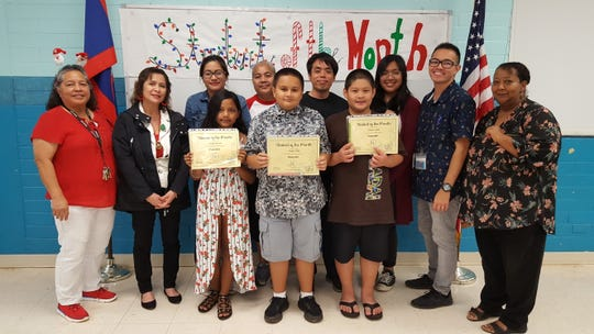Guahan Academy Charter School's November Student of the Month awardees on Dec. 19. Pictured from left, front row: C'naji Rabon; Jaden Hall and Shane Casil. Back row: Mary Mafnas, Lynda Hernandez-Avilla, Jennifer Camacho, Onania Snively, James Pangelinan, Ammika San Jose, Franklin Castro and Meredes Pinto.