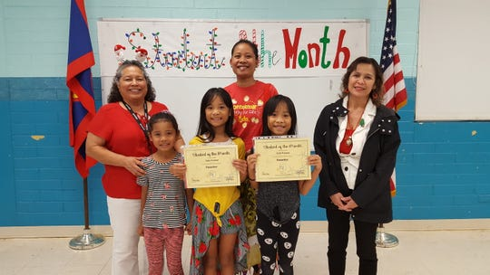 Guahan Academy Charter School honored its November Student of the Month awardees on Dec. 19. Pictured in front, from left: Jaydeen Kaneso; Jada Kaneso and Jade Kaneso. Back row: Mary Mafnas, dean of Elementary Guahan Academy Charter School; Teilin Kaneso and Lynda Hernandez-Avilla, dean of Secondary Guahan Academy Charter School.
