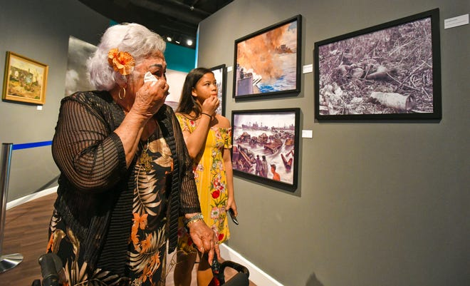 War survivor, Cynthia Tenorio Terlaje, wipe tears from her eyes as she and her grandchildren visit the Guam Museum in this June 28, 2019, file photo.
