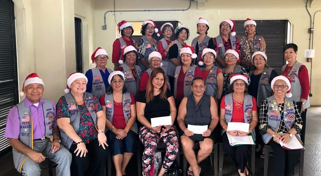 The Guam Sunshine Lions Club presented monetary donations to help defray medical treatment expenses for Ruben S. Loney, 63, of Yigo, Carolyn Magpayo, 62, of Yona, and Saturnino Masga, 41, of Tamuning on Dec. 21at the Chamorro Village. Seated with members is Pruleen Loney (on behalf of father R. Loney), Magpayo, Lions Dot Leon Guerrero (on behalf of S. Masga), and Jovie Mejorada.