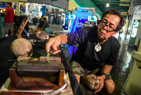 Master Carver Greg Pangelinan sharpens of of the many blades he uses in this March 30, 2019,  file photo. Guamtraditional and contemporary artists affected financially by the pandemic can apply for up to $5,000 in relief funds.