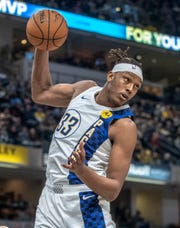 Myles Turner of the Indiana Pacers pulls down a rebound against the Philadelphia 76ers at Indiana Pacers, Bankers Life Fieldhouse on Dec. 31. Turner, at 6-11, is pulling down just 5.7 total rebounds, his lowest since his rookie season when he was a part-time starter.