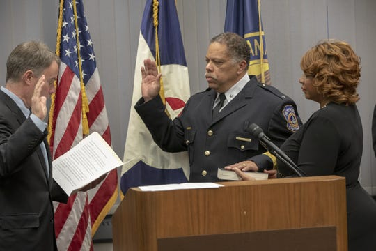 Mayor Joe Hogsett swears in new Indianapolis Metropolitan Police Department chief Randal (Randy) Taylor, as his wife Sandra Chapman stands by, Indianapolis, Tuesday, Dec. 31, 2019.
