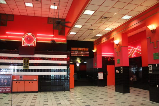 Before renovations, the Cinemark Movies 8 theater was known for its bold black, white and red color scheme.