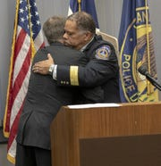 New Indianapolis Metropolitan Police Department chief Randal (Randy) Taylor, gets a hug from Mayor Joe Hogsett, Indianapolis, Tuesday, Dec. 31, 2019.