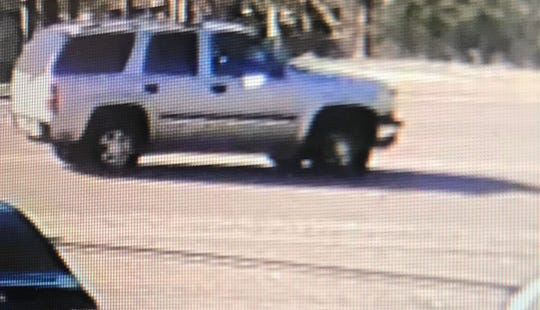 Police say an occupant or occupants of this light-colored vehicle fired shots into another car on Tuesday, Dec. 31, 2019, wounding two children. The shooting happened on Medgar Evers Boulevard.