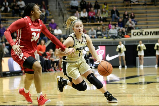 Purdue guard Karissa McLaughlin (1) drives against Wisconsin forward Imani Lewis (34) during the fourth quarter of a NCAA women's basketball game, Tuesday, Dec. 31, 2019 at Mackey Arena in West Lafayette.