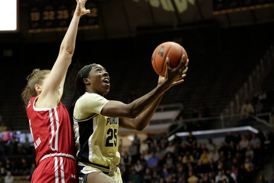Purdue guard Tamara Farquhar (25) goes up for a layup past Wisconsin guard Julie Pospisilova (5) during the first quarter of a NCAA women's basketball game, Tuesday, Dec. 31, 2019 at Mackey Arena in West Lafayette.