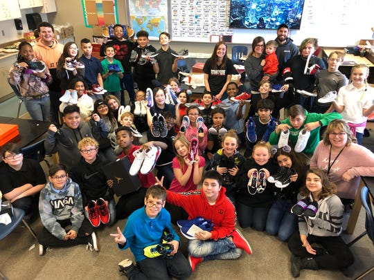 Sixth grade students at Lafayette Sunnyside Intermediate School pose with the new pair of shoes they received from New View Doors and Windows on Dec. 20, 2019. New View donated 47 pairs of shoes to the children.