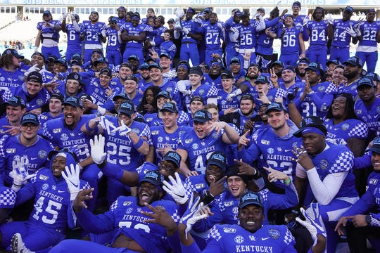 Dec 31, 2019; Charlotte, North Carolina, USA;  Kentucky Wildcats team poses for a photo after the trophy presentation of the Belk Bowl at Bank of America Stadium. Mandatory Credit: Jim Dedmon-USA TODAY Sports