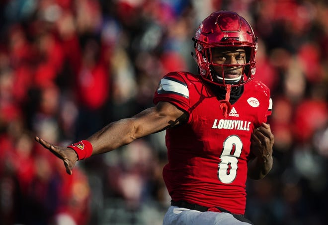 UofL quarterback Lamar Jackson strikes the Heisman pose after a late touchdown against the University of Kentucky in the Governor's Cup. UK would go on to win the game, but Jackson would later claim the Heisman trophy. Nov. 26, 2016