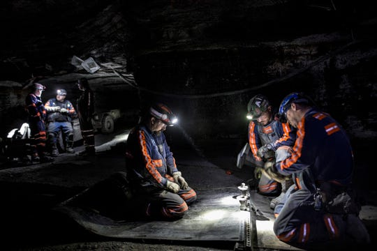 Miners at the newly reopened Kingdom Coal mine in Knott County work on repairing a belt in a ceiling fall area. Miners in the area are optimistic following Trump's election that mining operations may begin to reopen in Appalachia. March 8, 2017