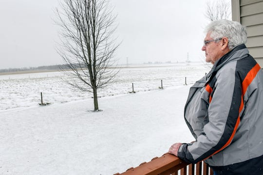 Gary Walters looks out at the 126 acres of his property he's under contract to sell to Geronimo Energy on Tuesday, Dec. 31, 2019. The company is proposing an 850-acre solar array in Benton Township.
