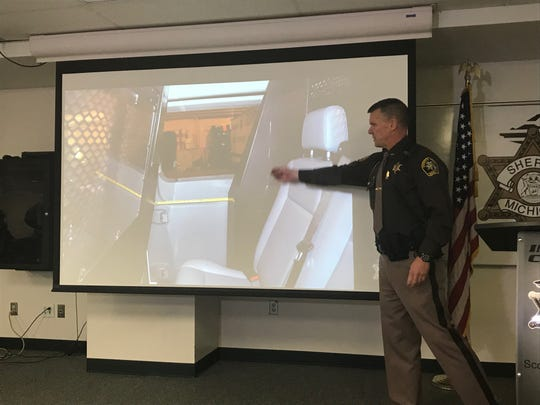 Ingham County Sheriff Scott Wriggelsworth points to a photo of the transport van that Marquis Oliver was riding in when he opened the side door and jumped out. Wriggelsworth spoke at a press conference Dec. 31, 2019, to discuss the results of an investigation into Oliver's death.