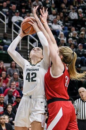 Michigan State's Kayla Belles, left, shoots as Nebraska's Kate Cain defends during the first quarter on Tuesday, Dec. 31, 2019, at the Breslin Center in East Lansing.