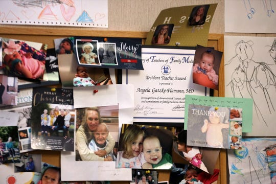 Personal photos are seen in the office of Dr. Angela Gatzke-Plamann at the Necedah Family Medical Center in Necedah, Wis., on Nov. 7, 2019. Gatzke-Plamann is married to another doctor in the practice, Dr. Ryan Plamann, the only pediatrician in Juneau County. Gatzke-Plamann says it is challenging to make room for a buprenorphine practice as well as a family practice, but she considers it an important responsibility for her community.