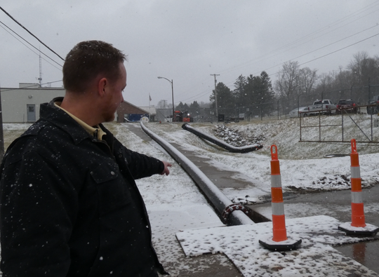 City of Mansfield water treatment supervisor William Wallace shows a temporary pipe installed above ground that is taking the water flow out of the water treatment plant so water department employees can perform maintenance at the Lexington-Springmill Road Water Treatment Plant.