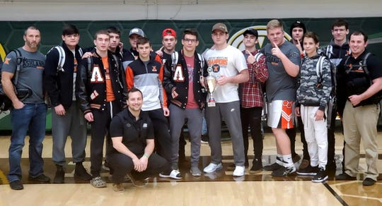 Sean Seder (front) and his Ashland Arrows celebrate being the top Division II team in last weekend's 44-team Medina Invitational Tournament. The Arrows are gunning for a fourth straight J.C. Gorman Invitational title this weekend at Mansfield Senior.
