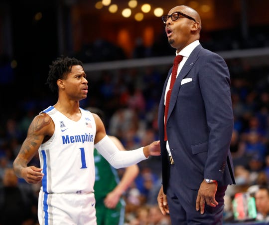 Memphis Tigers guard Alex Lomax talks to Head Coach Penny Hardaway during their game against the Tulane Green Wave at the FedExForum on Monday, Dec. 30, 2019.
