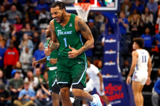 Tulane Green Wave guard and Memphis native K.J. Lawson celebrates a made shot during their game at the FedExForum on Monday, Dec. 30, 2019.