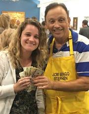 JCMI Bingo winner Cheryl Cruwys with Stephen Chasin.