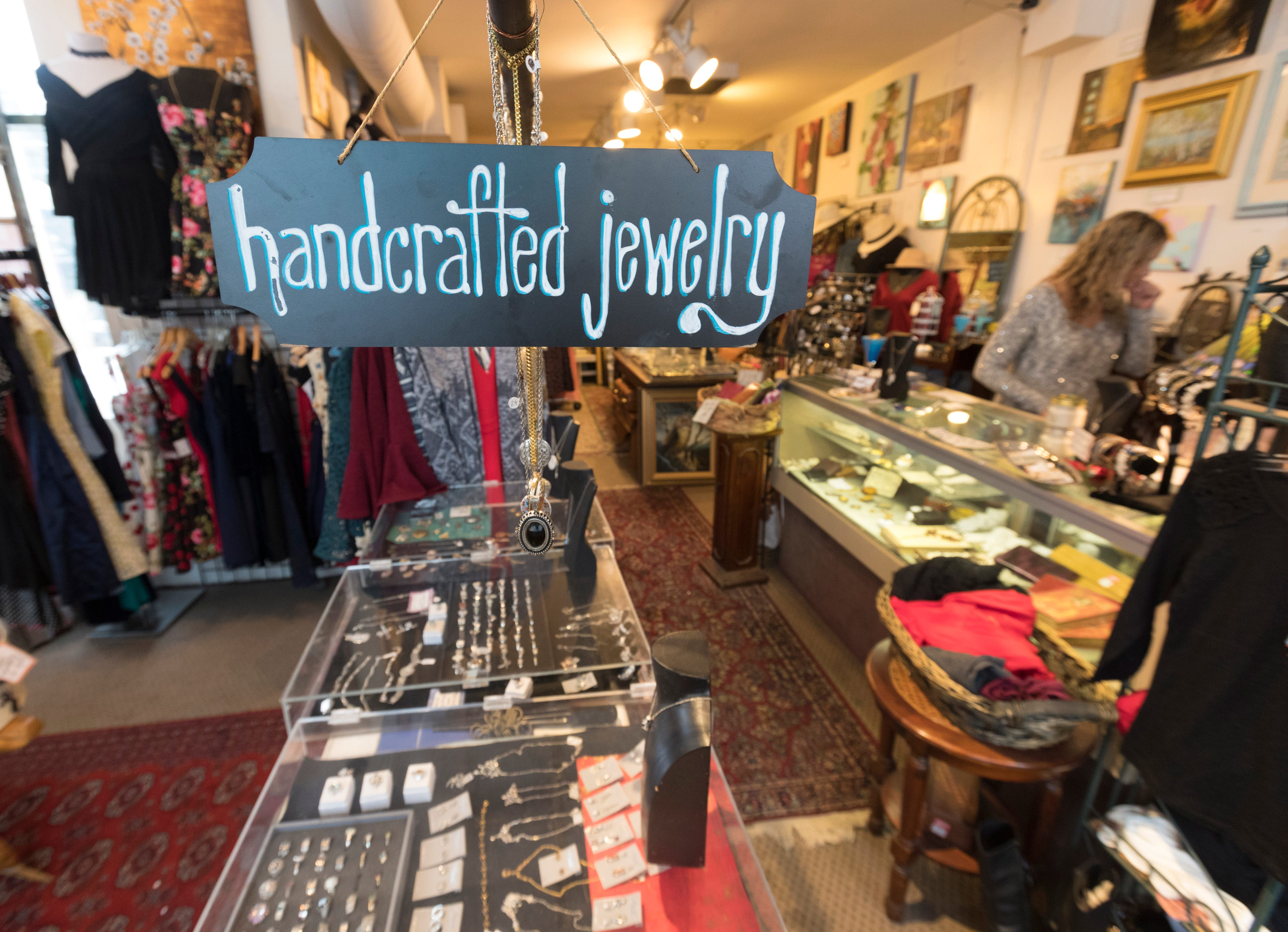 Jewelry and clothes are displayed Tuesday at Uncommon Items, which is having a moving sale.