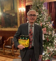 Wisconsin Gov. Tony Evers has wagered a six pack of Spotted Cow beer against a bottle of Oregon wine from Oregon's governor for the Rose Bowl.