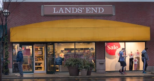 Shoppers exit the Lands' End store Saturday at the Riverpoint Village Shopping Center,  8777 N. Port Washington Road in Fox Point.