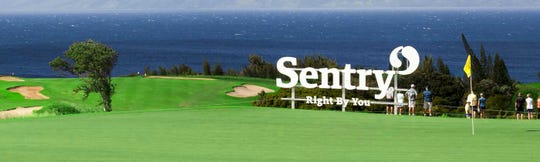 A Sentry sign dots the landscape at The  Plantation Course at Kapalua in Maui, Hawaii.