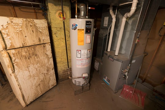 Maria Santoy's refrigerator and furnace were destroyed by muddy floodwaters from a watermain break.