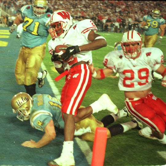 Wisconsin cornerback Jamar Fletcher returns an interception for a touchdown against UCLA in the 1999 Rose Bowl.