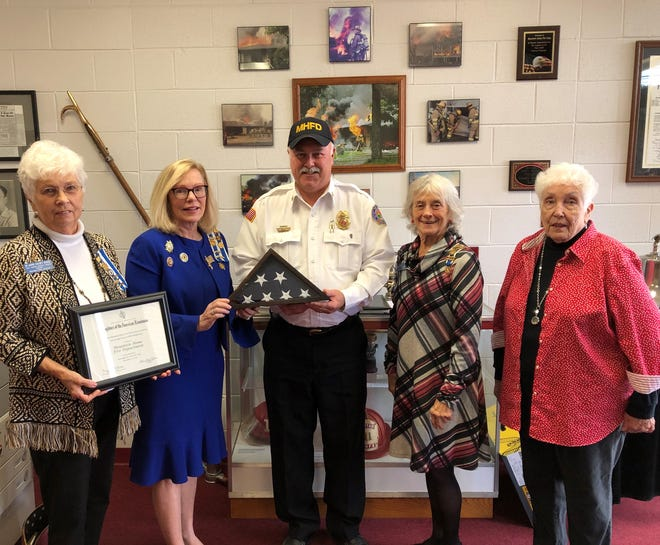 The Captain Nathan Watkins Chapter of the Daughters of the American Revolution recently presented Mountain Home Fire Chief Ken Williams with an American that was flown over D.A.R. Headquarters in Washington D.C. for recognition of providing fire protection and for their community involvement. Pictured from left to right are JoAnne Dukes, Vice Regent; Caroline Carroll, Registrar, Fire Chief Ken Williams, April Baily, Regent and JoBelle Zimmerman Honorary Regent.