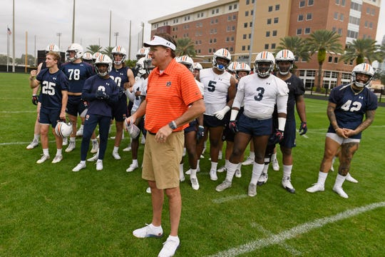 Auburn coach Gus Malzahn with the team's seniors after their final practice for the Outback Bowl on Monday, Dec. 30, 2019 in Tampa, FL.