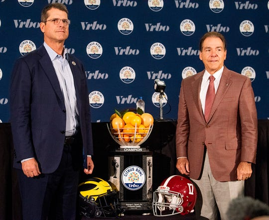 Michigan head coach Jim Harbaugh and Alabama head coach Nick Saban pose or photos during the Citrus Bowl coaches press conference in Orlando, Fla., on Wednesday December 31, 2019.