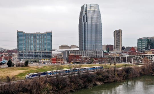 The skyline includes the new Pinnacle building and Encore on the south of Broadway in Nashville, Tenn., Wednesday, Dec. 23, 2009.