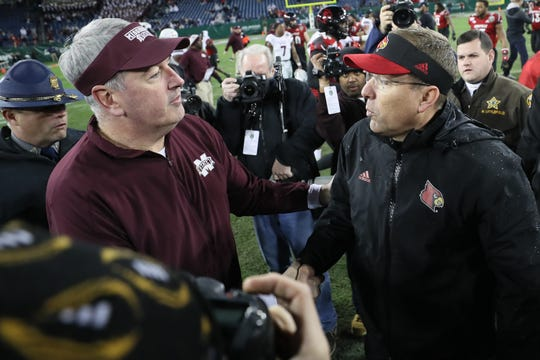 Mississippi State head coach Joe Moorhead shakes hands with Louisville head coach Scott Satterfield after Louisville's win in the Music City Bowl at Nissan Stadium in Nashville, Tenn., on Monday, Dec. 30, 2019.