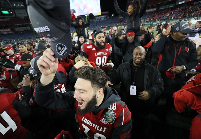 Louisville celebrates its win over Mississippi State in the Music City Bowl at Nissan Stadium in Nashville, Tenn., on Monday, Dec. 30, 2019.